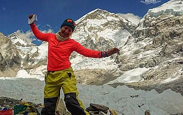 Everest Base Camp journey in Nepal. A women at Everest Base camp with joy of accomplishment around world's highest peak.